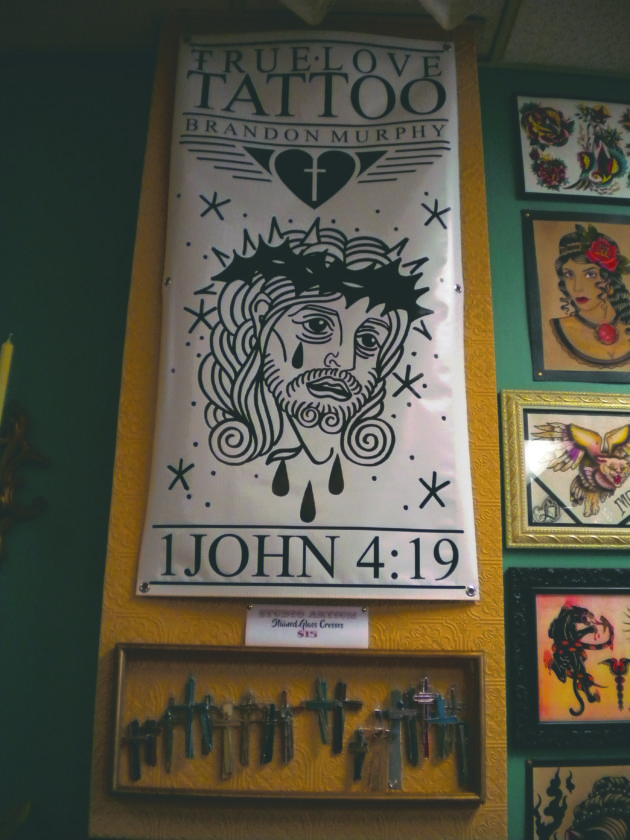 Some of Murphy's artwork, inspired by his Christian faith, is shown inside the parlor.