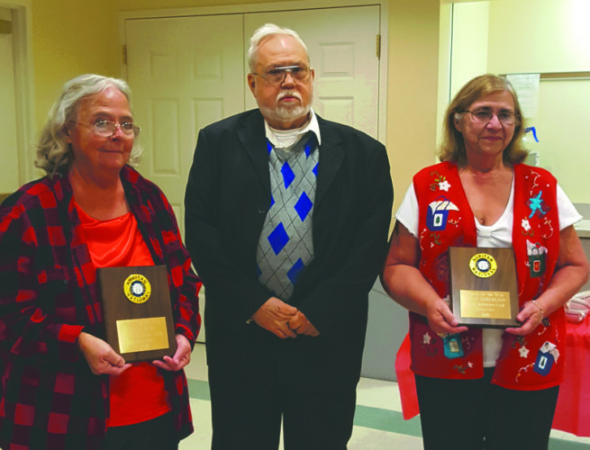 (Photo by Jennifer R. Young) From left, Ellen Hall, Roger Dailey and Shelvy Darlington pose Tuesday night during the South Jefferson Ruritan Club Ruritan of the Year award ceremony in Charles Town.