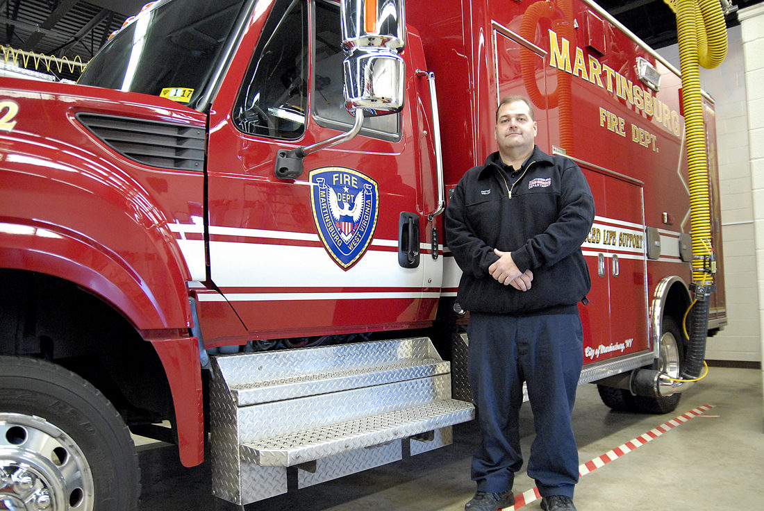 Journal photo by Jeff McCoy Captian David Weller is pictured in front of a Martinsburg Fire Department ambulance at Co. 1.