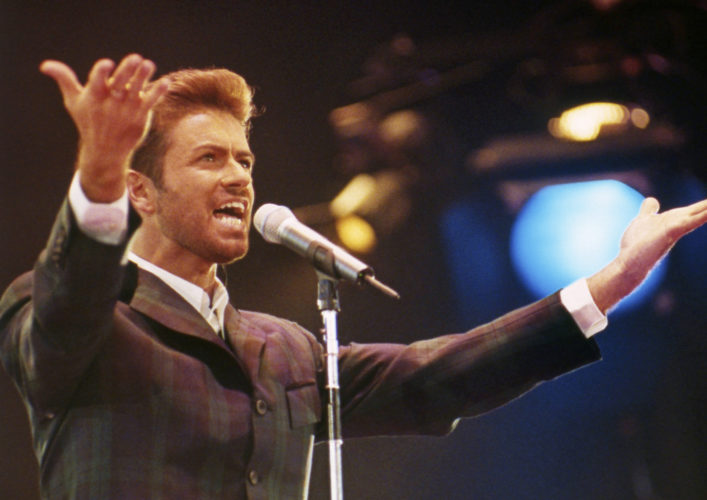 "FILE - In this Dec. 2, 1993 file photo, George Michael performs at ""Concert of Hope"" to mark World AIDS Day at London's Wembley Arena. According to a publicist on Sunday, Dec. 25, 2016, the singer has died at the age of 53. (AP Photo/Gill Allen)"