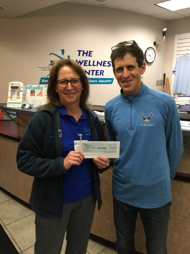 (Submitted photo) Pictured, from left, are Dana DeJarnett, representing The Wellness Center at Berkeley Medical Center, and Dr. Mark Cucuzzella of Freedom's Run.