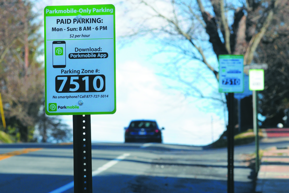 (Journal photo by Ron Agnir) Signs for a new pay parking system are seen Thursday along Washington Street in Harpers Ferry.