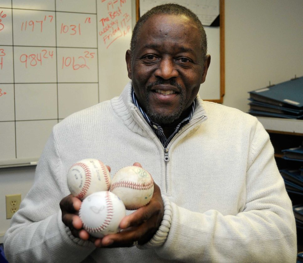 Vic Holmes shows balls from each of the three Class AAA baseball championship games won by Martinsburg while he coached the team. Holmes will be inducted into the West Virginia Baseball Coaches Association Hall of Fame later this month. (Journal photo by Ron Agnir)