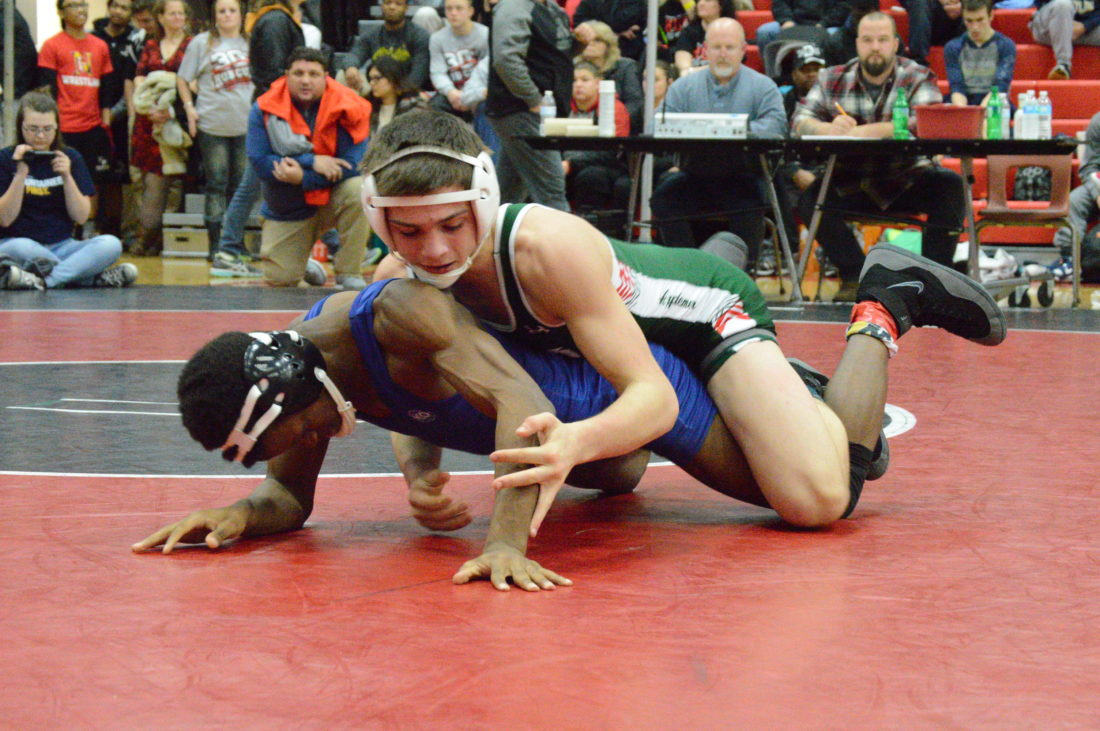 Musselman's Joey Miller, top, clams third place with a victory over C.J. Cramma of Magruder, Maryland. (Journal photo by Jessica Manuel)