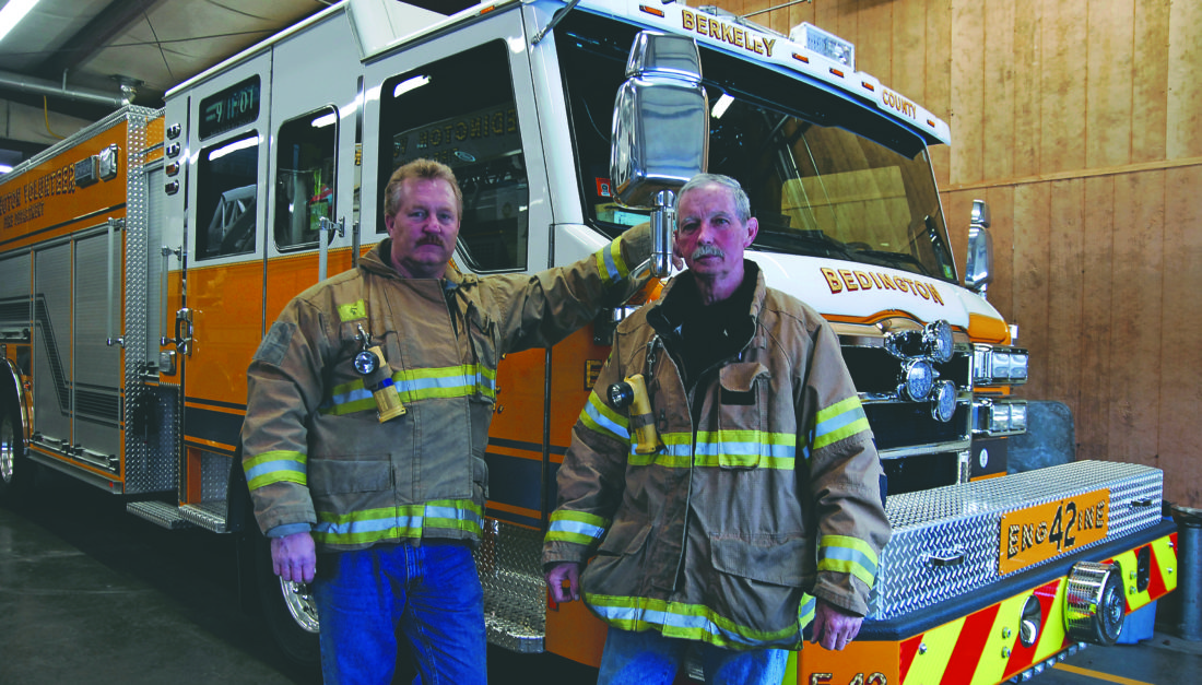 Journal photo by Jeff McCoy Firefighter Tom Newcomb, left, and Chief David Brining stand ready for the next call at Station 49 on Tuesday for the Bedington Volunteer Fire Department.
