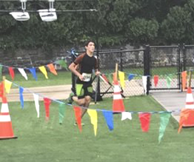 Jefferson's Nico Feigo enters the final stretch of the 2016 Freedom's Run in Shepherdstown. Feigo earned a chance to run in Australia after being recruited by Down Under Sports.