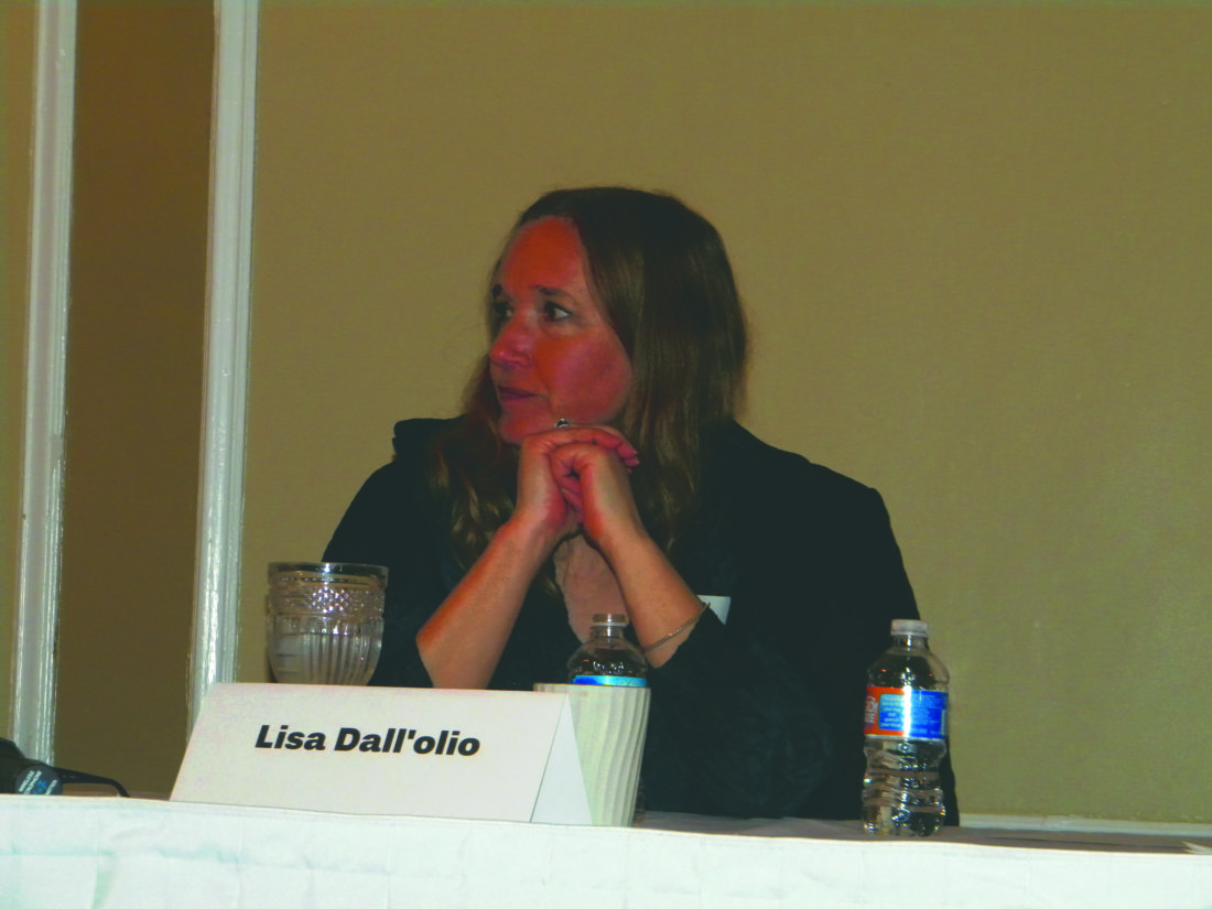 (Journal photos by Jim McConville) Architect Lisa Dall'olio to other panelists during the forum Thursday in Martinsburg.