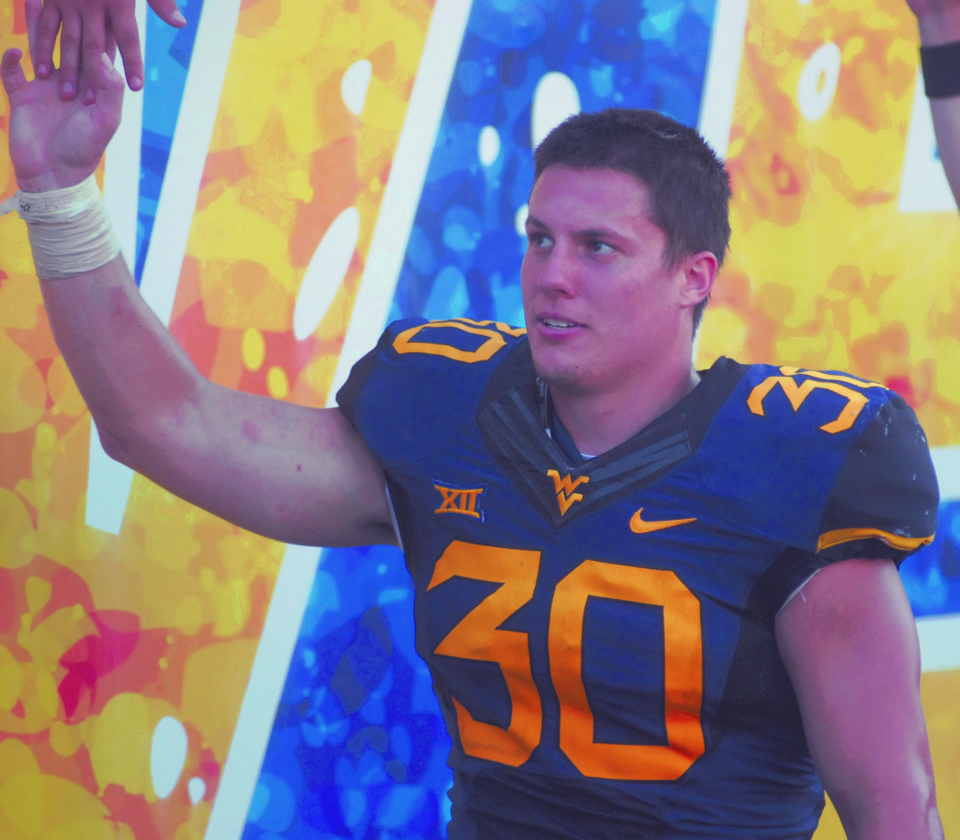 Journal file photo by Rick Kozlowski Martinsburg graduate Justin Arndt finished his career with West Virginia by being named the team's defensive MVP.