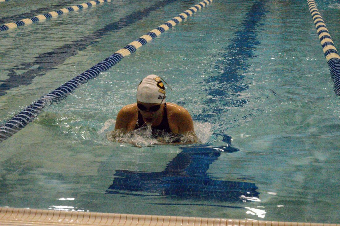Kaelyn Gardner leads the 100 breaststroke during the EPAC meet. TheCougar girls won the girls title.
