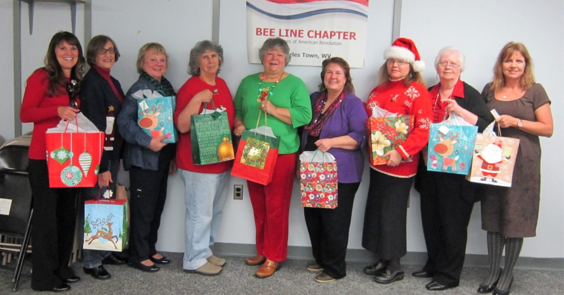 Sharon Webb (VAMC staff), Susan Heflebower, Ann Ebersole, Lynn Welsh, Emily Cooper, Sharon Carrigan, Kate Absher, Darla Treat Courtney, and Shari Jordan (VAMC staff) join forces to bring holiday cheer to women vets served by the Martinsburg VA Medical Center. (Submitted photo)
