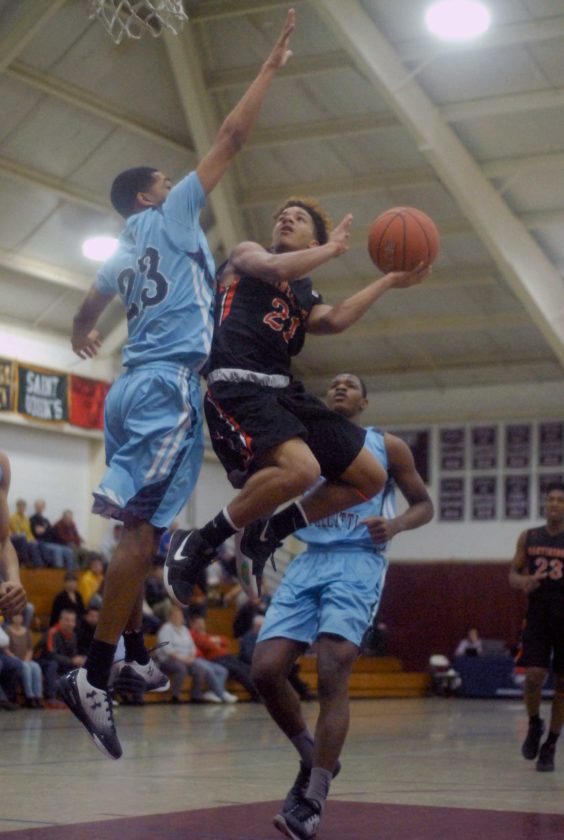 Martinsburg's Jarod Bowie goes up against Everette Hammond of St. Vincent Pallotti on Saturday at the Saint James Invitational Tournament. (Journal photo by Eric Jones)