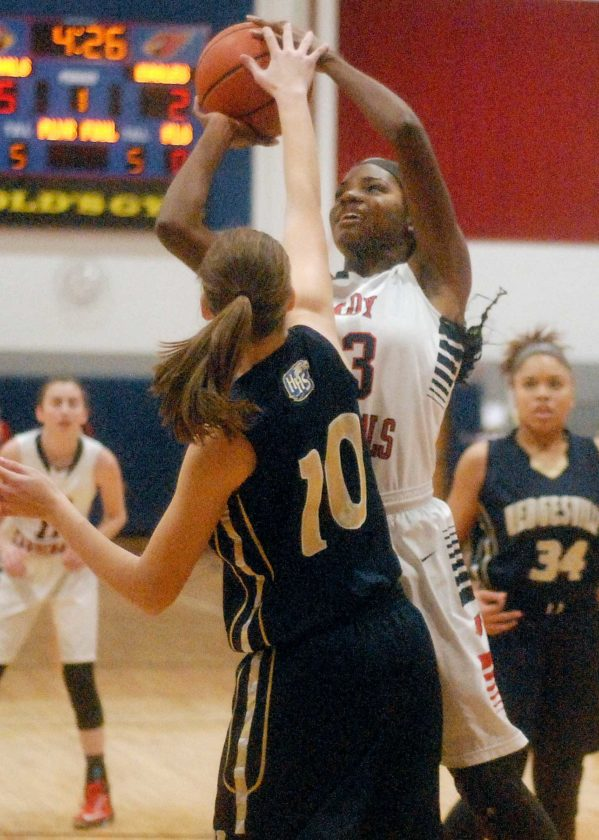 Spring Mills' Syndei Taylor shoots over Hedgesville's Emily Bethel during Thursday's game. (Journal photo by Jessica Manuel)