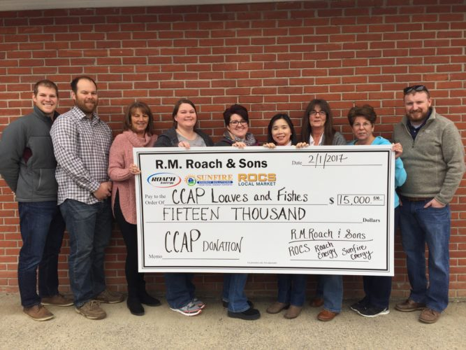 Members of CCAP and Roach & Sons, Inc., hold a presentation check for $15K given to CCAP. (Submitted photo)