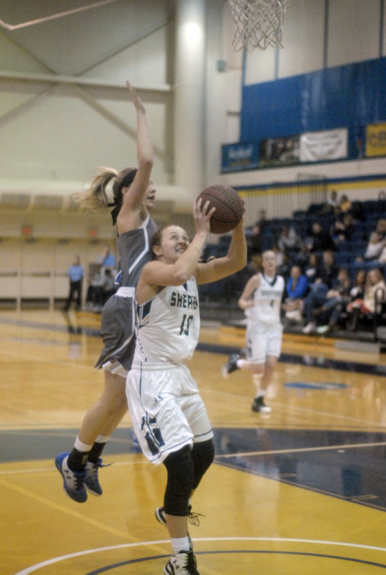 Shepherd's Cara Mason goes up for a jumper as she avoids defense from Urbana during Saturday's game at the Butcher Center.