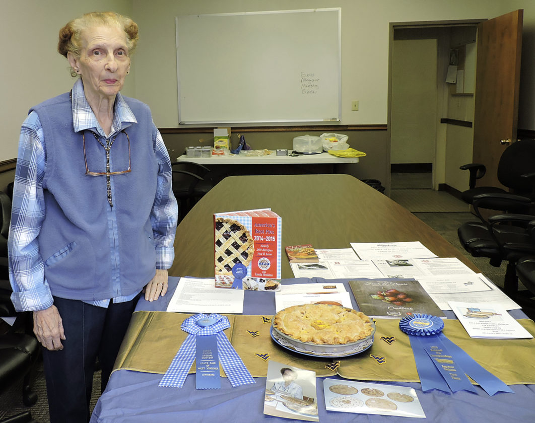 AP photo Carolyn Blakemore stands next to a display that presents her awards for best apple pie in Fairmont, W.Va. There is nothing more American than apple pie, and Blakemore has been known to make the best apple pie for years.