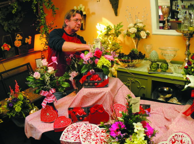 Pictured above, William Binkley, sales manager at Depot Florists, finishes making Valentine's Day floral arrangements on Monday afternoon in Martinsburg. Roses, lilies and hydrangeas have been popular choices this year.