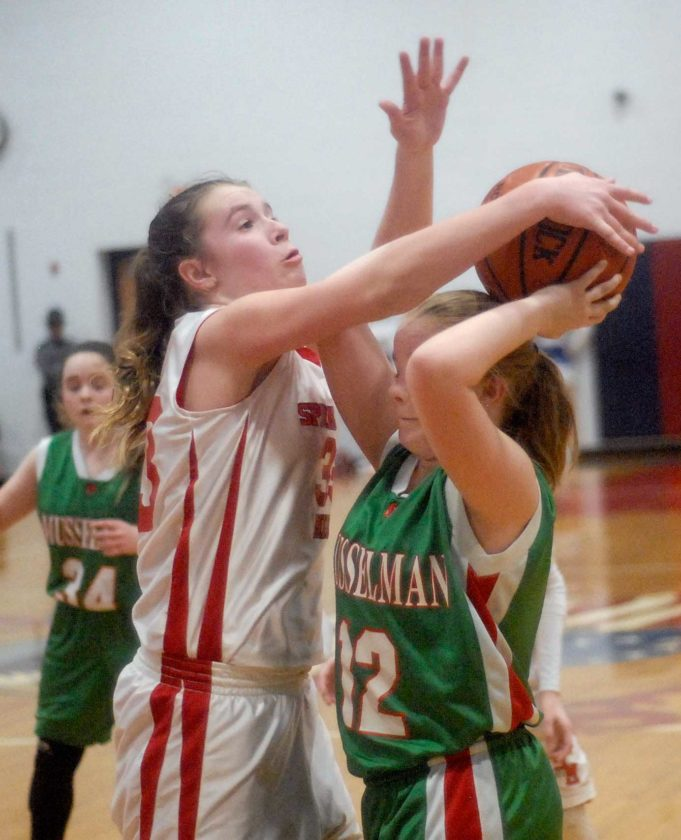 Spring Mills' Kiran Cole guards Musselman's Chloe Womble during Thursday's seventh-grade MAC championship game. See more photos on CU.journal-news.net. (Journal photo by Rick Kozlowski)