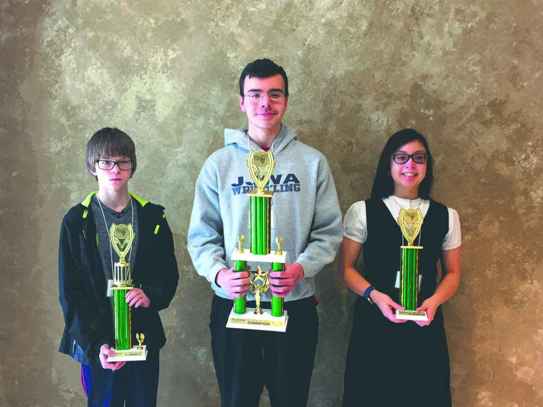 (Photo by Toni Milbourne) From left, first runner-up Ethan Fisher, Harpers Ferry Middle School; first place winner Lucas Mooney, St. James Homeschool Group; and second runner-up Alyssa Powers, St. James Homeschool Group, are shown after the National Spelling Bee preliminary competition Saturday. Judges were Judy Ballenger, Chris Edwards and Peggy Fuller. Pronouncer was Toni Milbourne, editor of the Shepherdstown Chronicle. Mooney won an all expense paid trip to Washington, D.C., to spend 7 days and nights at the Gaylord National Resort and Convention Center at the National Harbor. Nearly 40 students from around the tri-county area competed. This was Mooney's second consecutive win.