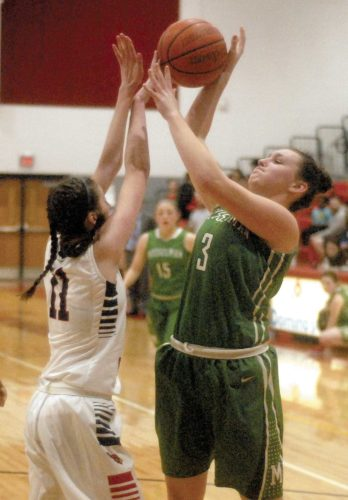 Journal photo by Rick Kozlowski Spring Mills' Sydney Shaw blocks a shot by Musselman's Haley Musselman during a Class AAA, Region II, Section 1 semifinal game on Monday in Spring Mills.