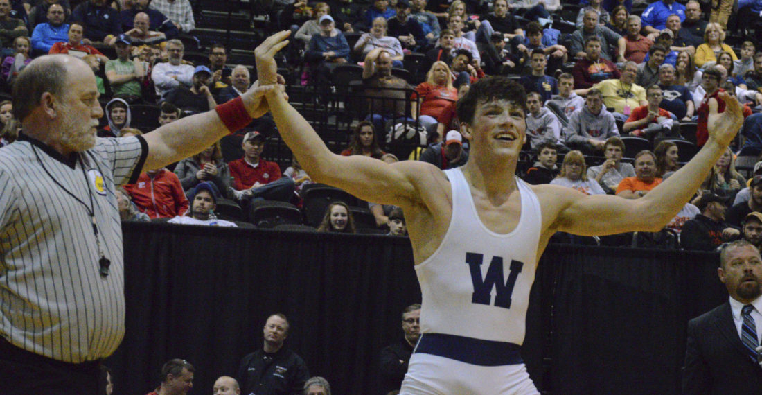 Journal photo by Jessica Manuel Cameron Pine from Washington raises his arms in celebration after winning a Class AAA state wrestling championship at 160 pounds on Saturday.  (Journal photo by Jessica Manuel)