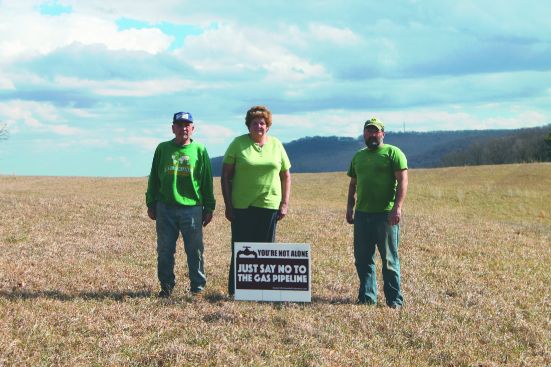 Journal photo by Danyel  vanReenen David Kerns and Patricia and Dean Kesecker stand in the field where Mountaineer Gas Company has proposed building their natural gas pipeline.