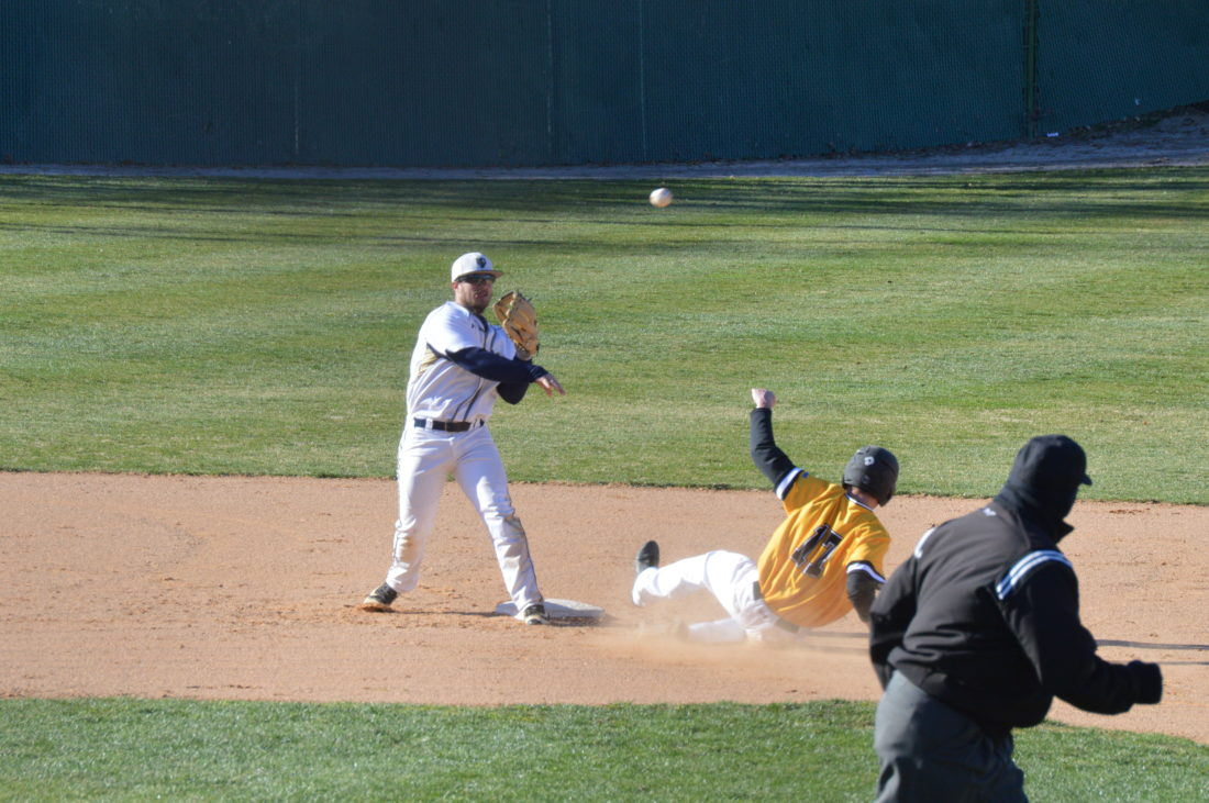 Journal photo by Jessica Manuel Shepherd shortstop Brian McCourt forces out Millersville's Manning Brookens at second base during Game 2 of Saturday'sdoubleheader in Shepherdstown.