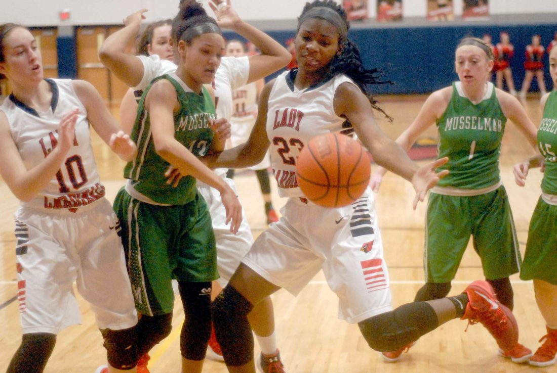 Spring Mills' Sydnei Taylor, middle, goes for a loose ball against Musselman's Janaia Fargo on Feb. 20, 2017. Taylor is among a trio of seniors who have helped build the Spring Mills girls basketball program from the first season to a state berth this year.