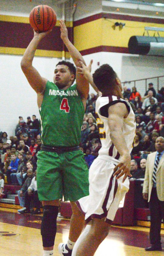 Musselman's Latrell Warr, left, shoots over Jefferson's Alex Tennant during Tuesday's game Shenandoah Junction. See more photos on CU.journal-news.net.(Journal photo by Jessica Manuel)