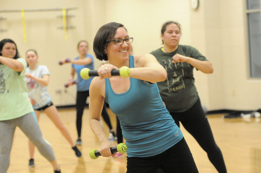 """Mary dances while using 1 pound weights euphemistically referred to as """"maracas"""" by the Zumba Dance Class at Shepherd University Wellness Center. (Journal Photo by Ron Agnir)"""