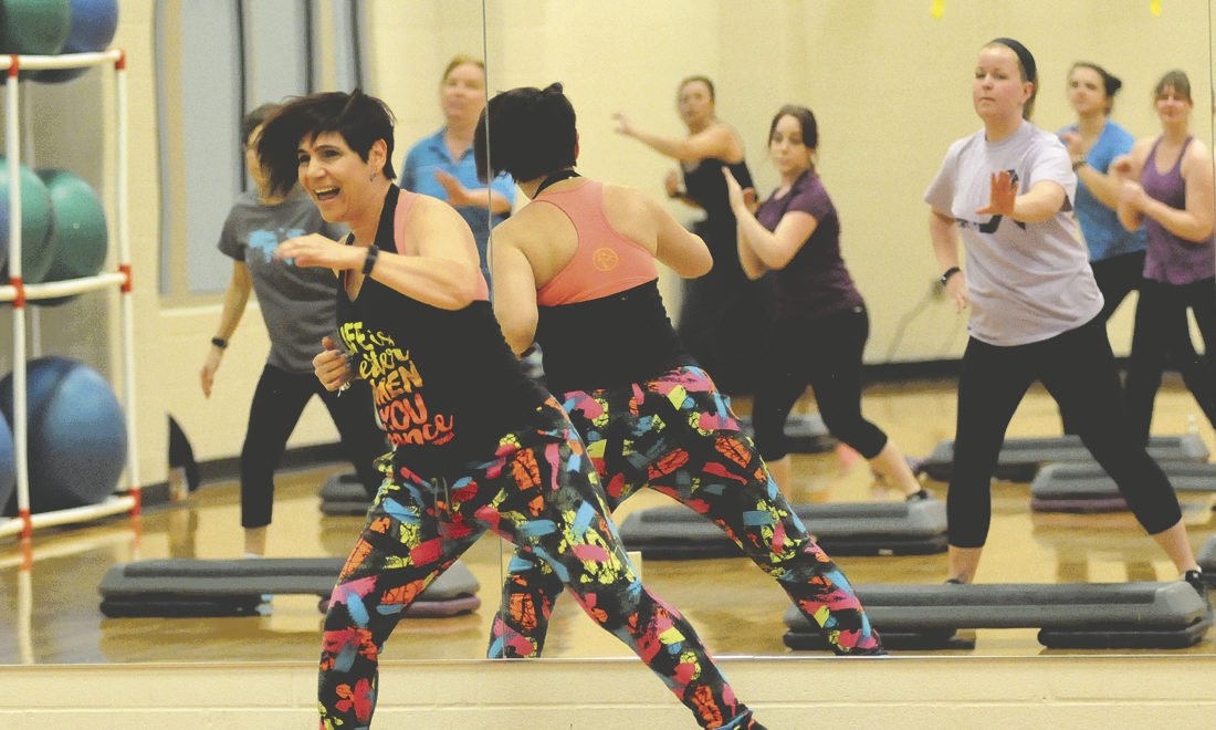 Ineabella Ferreris, Zumba Instructor at Shepherd University Wellness Center leads a Zumba class through a series of Zumba step drills. (Journal Photo by Ron Agnir)