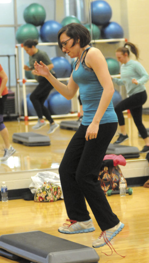 Mary doing Zumba Step with a loose shoelace during the  Zumba Dance Class at Shepherd University Wellness Center. (Journal Photo by Ron Agnir)