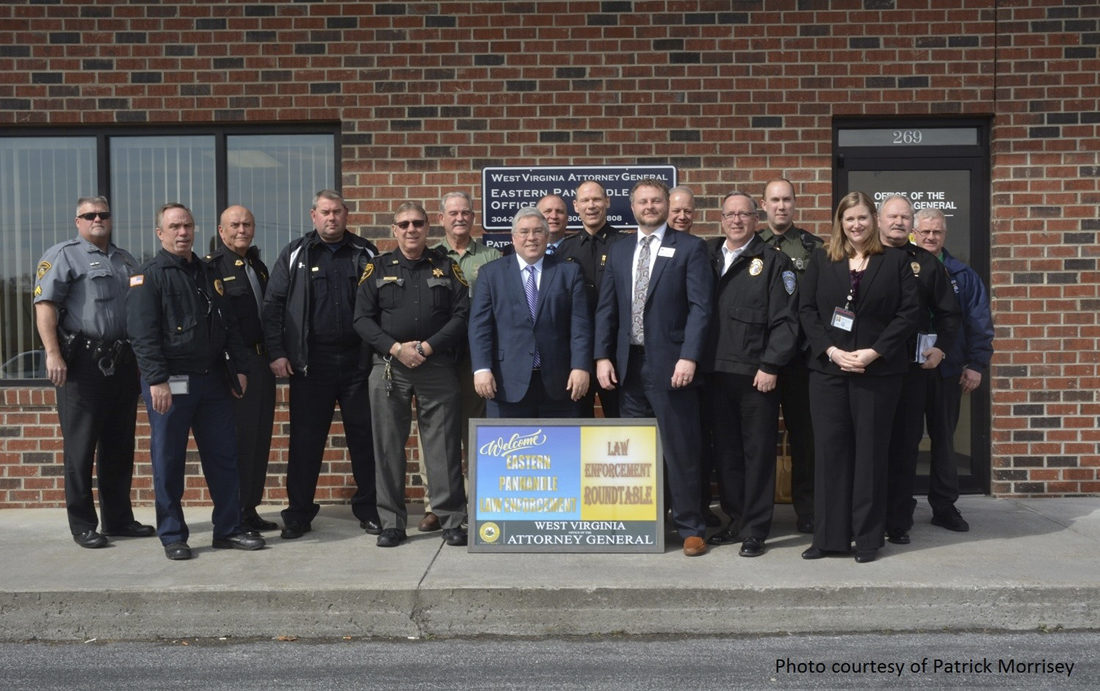 Submitted photo Attorney General Patrick Morrisey, poses with a group of law enforcement representatives from across the Eastern Panhandle on Monday in Martinsburg.