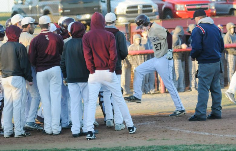 Jefferson's Austin Bulman, right, stomps on home plate before getting mobbed by teammates after he hit a home run against Smithsburg, Md., during the third inning Wednesday evening in Shenandoah Junction. See more photos on CU.journal-news.net. (Journal photo by Ron Agnir)