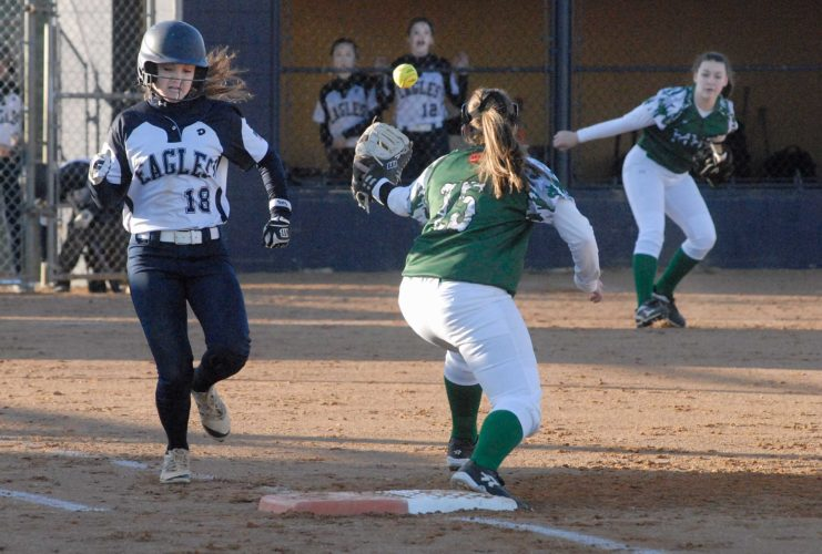 Journal photo by Eric Jones Hedgesville's Isabella Forte, left, reaches first base as the the throw from Musselman's Haley Musselman (11) goes wide of first baseman Makayla Ambrose's glove. See more photos on CU.journal-news.net. (Journal photo by Eric Jones)