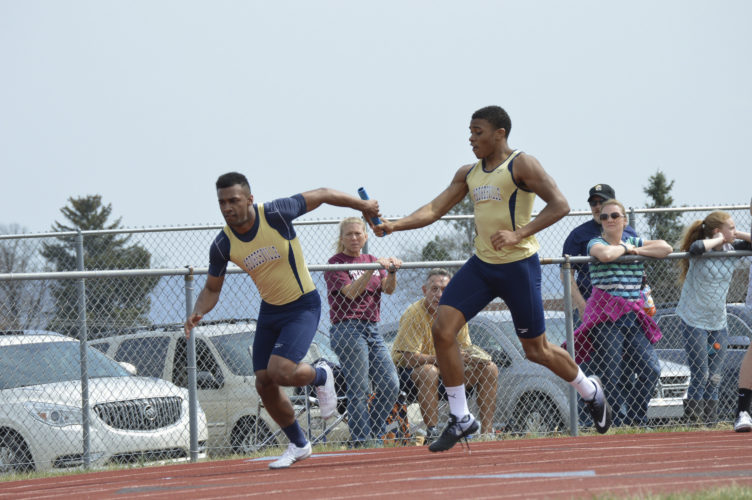 Journal photos by Jessica Manuel  Kyrae Ramos of Hedgesville takes a handoff from Timothy Campbell-Fowler during the Jim Taylor Relays on Saturday at Jefferson. The Eagles won the boys competition (Journal photo by Jessica Manuel)