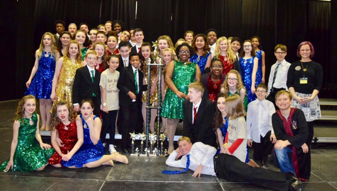 Members of the South Middle School show choir pose with their trophy. (Submitted photo)