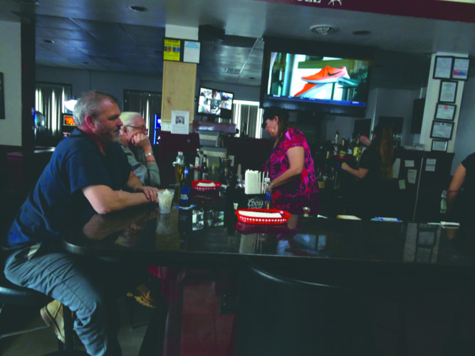 Patron at Laddies enjoy breakfast and a sports game. (Journal photo by Adranisha Stephens)