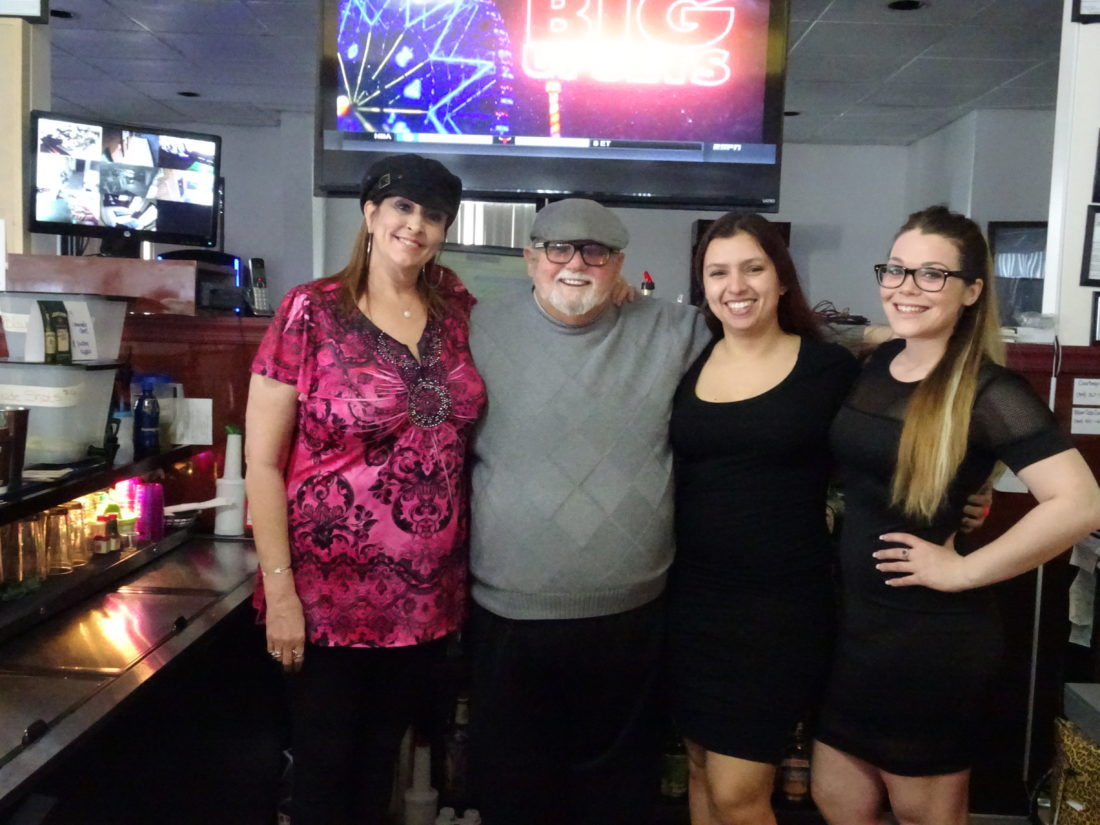 Shown are owner Laddie Jasper, second from the left, and his staff of Laddies bar.(Journal photo by Adranisha Stephens)