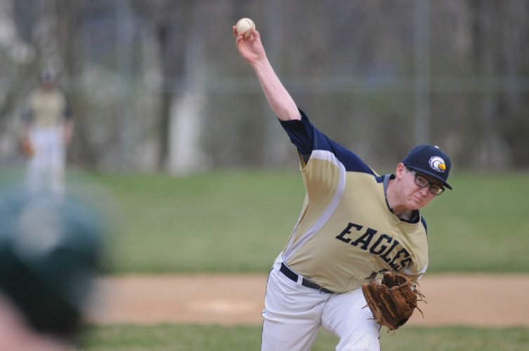 Hedgesville starting pitcher Adam Weaver throws against Hampshire on Monday. Weaver gave up just two hits in a strong outing against the Trojans.
