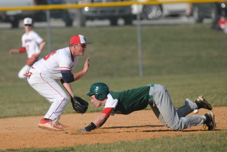 Musselman's Tyler Robinson dives into third base safely before Washington Jack Dubyak can apply a tag during the third inning on Tuesday afternoon in Charles Town. See more photos on CU.Journal-news.net. (Journal photo by Ron Agnir)