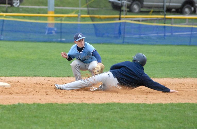 Phillip Barbour second baseman Nathan Baldwin (1) tags out Berkeley Springs' Anthony Clark during their game Friday afternoon in Berkeley Springs.