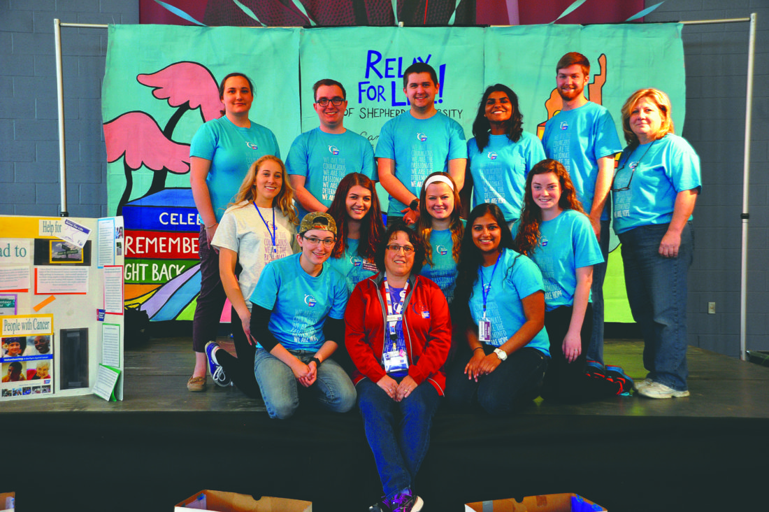 (Journal photo by Jeff McCoy) Cancer survivor and American Cancer Society Community Manager Penney Horner is surrounded by students that volunteered their time and money for the Relay For Life Event at Shepherd University.