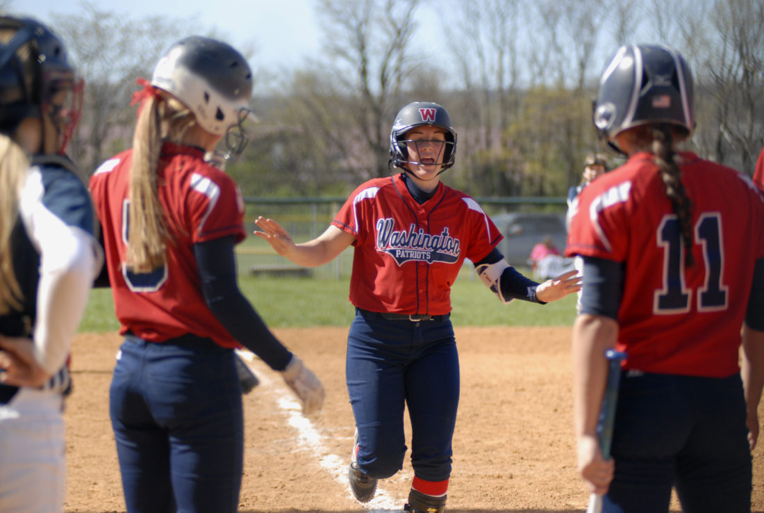 Washington's Taylor Cenate comes home after hitting a home run during the Patriots' games against Independence during the Musselman Mixer on Saturday.