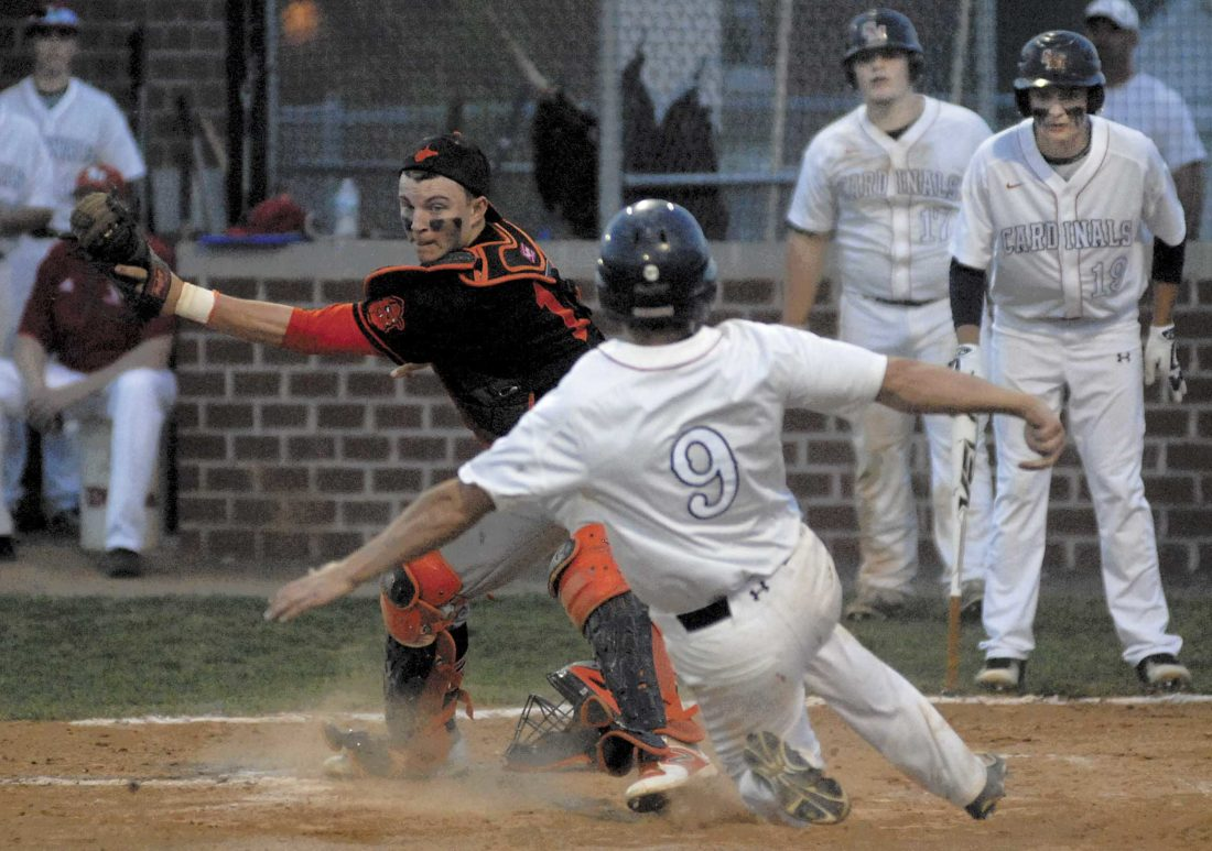 Spring Mills' Colby Werry, right, scores before Martinsburg catcher David Conner can apply the tag Tuesday evening at Spring Mills. (Journal photo by Rick Kozlowski)