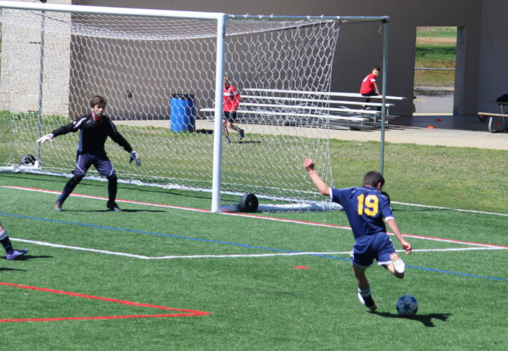 Mason Reddington from TCSCElite Black O3 prepares to take a shot on his way to scoring a goal against Mountain State in the West Virginia State League. (Submitted photo)