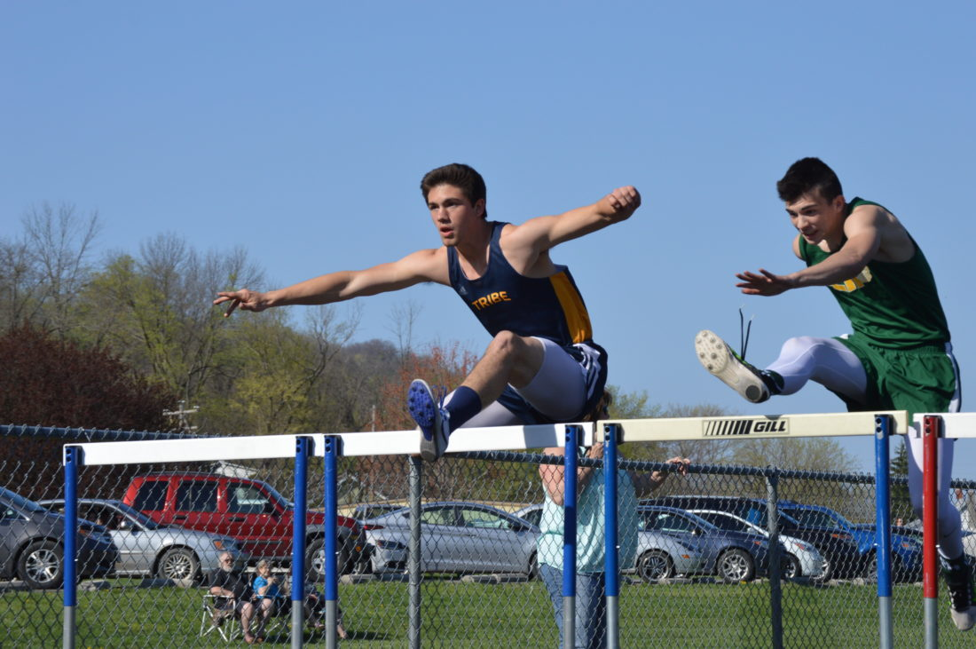 Berkeley Springs' C.J. Ryan, left, competes in the 110-meter hurdles during the Indians' quad-meet on Wednesday in Berkeley Springs. (Journal photo by Jessica Manuel)