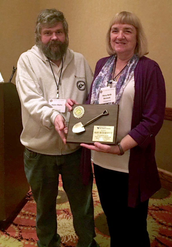 Myke Myles of the West Virginia Master Gardner Association presents Dr. Mary Beth Bennett with the Golden Trowel Award. (Submitted photo)