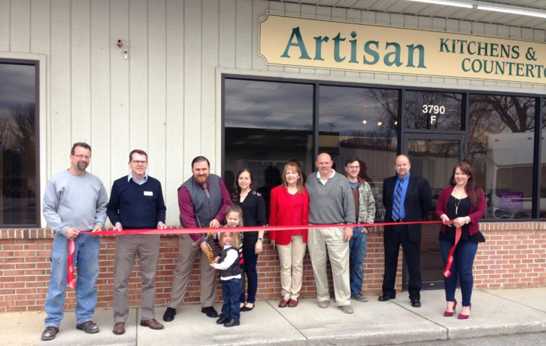 """Pictured, from left, are Stephen Joswick, Artisan's master trim carpenter; David Hart, president, EPHBA; W. Maurice """"Reece"""" Johnson III, president/owner, Fairway Homes & Services Inc. (DBA) Artisan Kitchens & Countertops; Johnson's son, Casen A. Johnson and daughter, Haley C. Johnson (master ribbon cutters) and wife, Stephanie Johnson, FHS Inc. board member; Rita P. Johnson, founding owner; W. M. """"Marty"""" Johnson Jr., vice president operations/founding owner of Fairway Homes & Services Inc. (DBA) Artisan Kitchens & Countertops; Patrick Johnson, owner/trim carpenter; David Hart, Edwin Miller Blvd. Branch Manager, First United Bank & Trust; Arissa Foreman, kitchen and bath design specialist and project manager. (Submitted photo)"""