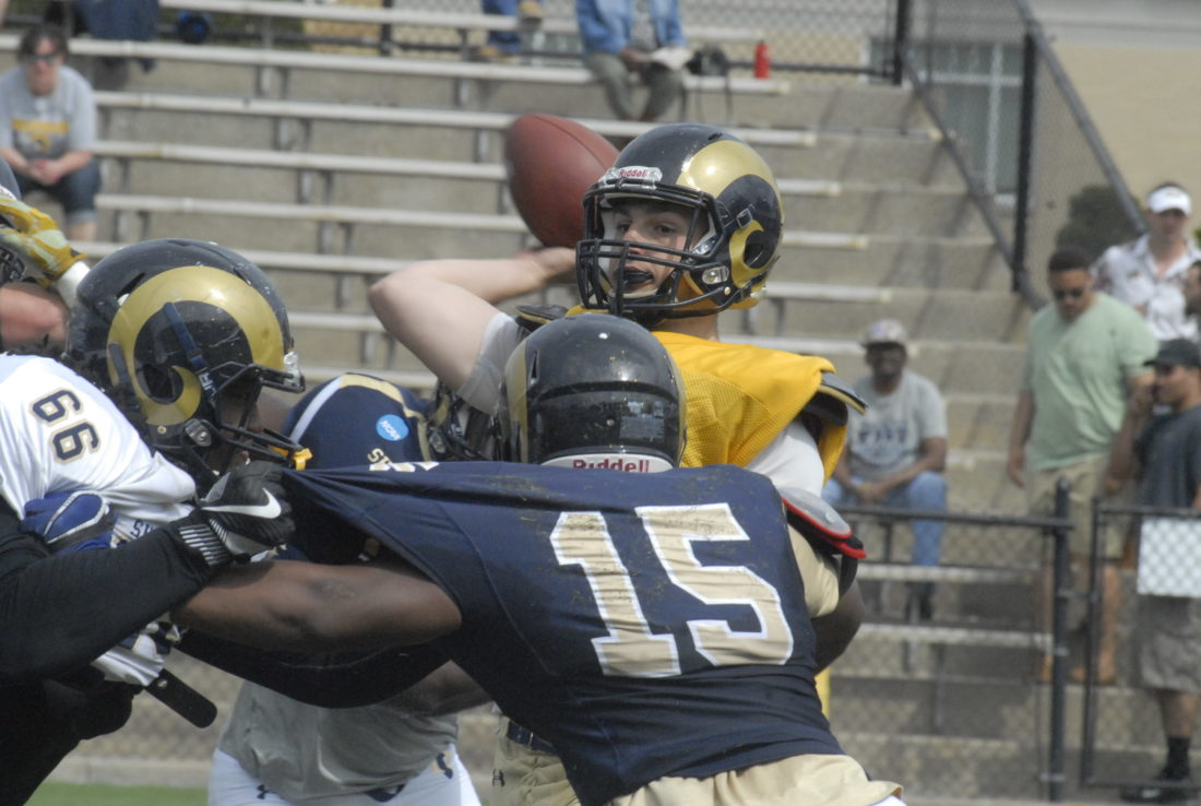 Journal photo by Rick Kozlowski Shepherd quarterback Stephen Curran looks to throw during the Rams' annual spring game on Saturday in Shepherdstown.