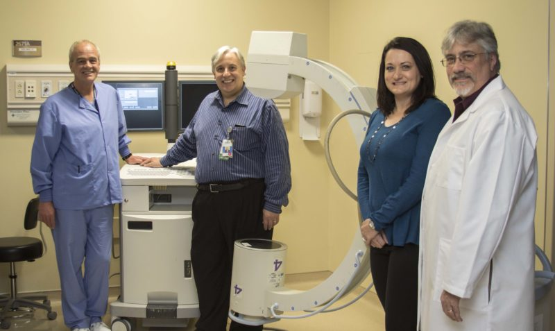 (Submitted photo) Pictured from left, with the donated x-ray machine, are Jeff Snoots, business manager of Surgical Services at Meritus Medical Center; Jesus Cepero, chief operating officer at Meritus Medical Center; Michelle McDaniel, medical imaging program coordinator at HCC; and Dr. Paul Marinelli, president of Associated Radiologists, P.A.